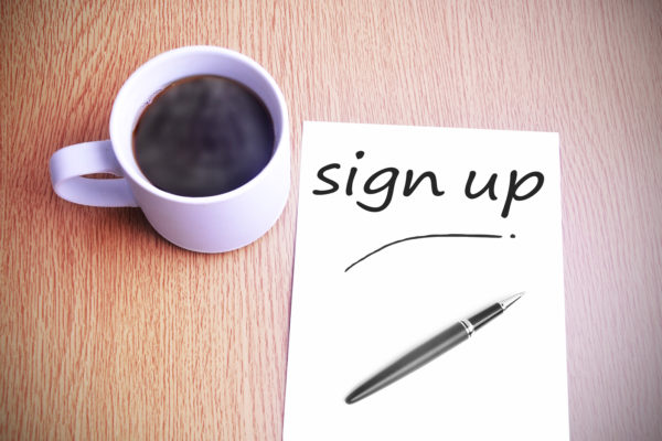 Black coffee on the table with note writing sign up