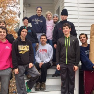 """The Crew participated in a """"yard blitz' in cooperation with SAJE Senior Ministries. We spent four hours raking the yards of six different senior citizens in our neighborhood."""