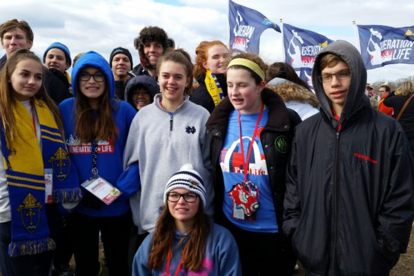Seven 8th graders, six high school students, and five adults represented St. Justin at the March for Life to show that we believe all human life is sacred from conception to natural death.