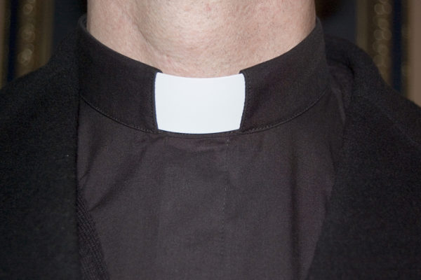Close up of the collar of a young priest